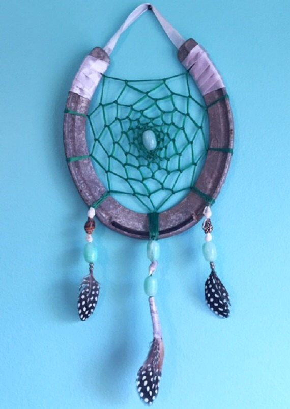 Horseshoe dreamcatcher with seashell accents by EarthDiverCreations on Etsy https://www.etsy.com/ca/listing/487180591/horseshoe-dreamcatcher-with-seashell