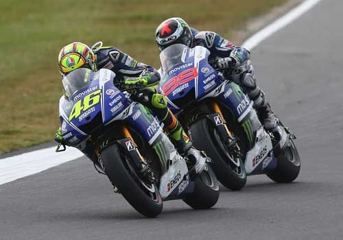 Totalposter.com -  Valentino Rossi of Italy and riding the #46 Movistar Yamaha MotoGp Yamaha leads Jorge Lorenzo of Spain riding the #99 Movistar Yamaha MotoGp Yamaha during the 2014 MotoGP of Australia at Phillip Island Grand Prix Circuit in Phillip Island, Australia