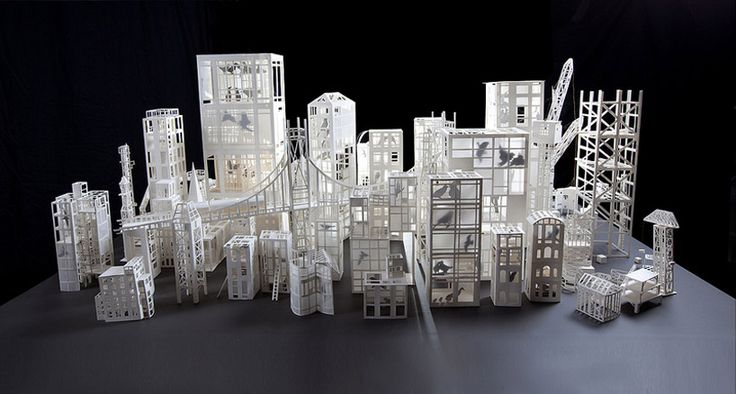 'aviary', 2010  image © stephanie beck   american stephanie beck carves cities from the urban landscape taken from experiences she has accumulated through her many journeys around the world.   thin layers of paper are applied over the miniature models revealing a method similar to oil painting. the lightness and fragility of the pieces are   a result of the cut outs done with scissors. the materialization of these volumes echo plans of cities halfway between dream and reality.