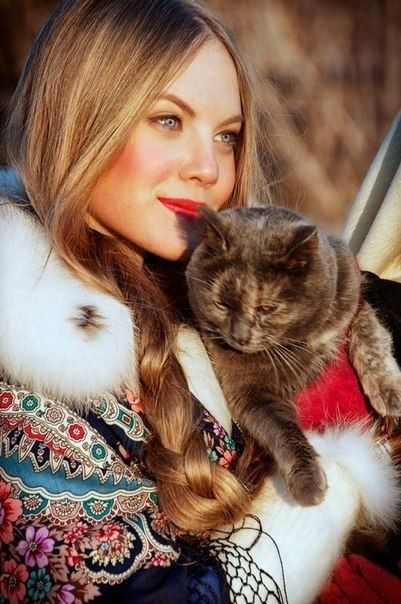 Russian girl with her cat.