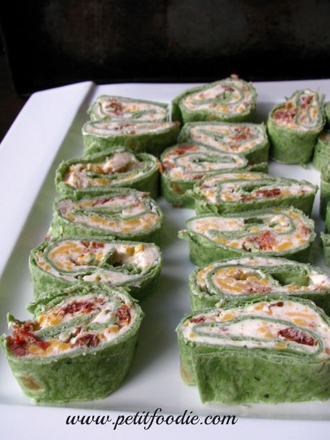Bacon Ranch Pinwheels 3 large spinach herb tortillas 1 C sharp cheddar cheese 3 pieces of bacon, cooked crumbled 1 8oz package reduced fat cream cheese, room temperature 2 heaping T sour cream 1 T dry ranch mix Instructions In a large mixing bowl combine cream cheese, sour cream and dry ranch mix. Fold in bacon and cheddar cheese. Spread cream cheese mixture on tortillas. Roll each tortilla tightly. Wrap in cling wrap and place in fridge for several hours. Slice when ready to serve.