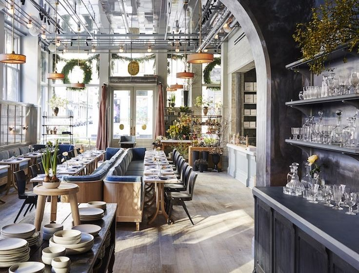 """A must-go spot in New York City: Roman and Williams' new SoHo flagship. Inside, a Parisian café and bakery (open until 11 p.m.), and a flower shop from """"local muse of botany"""" Emily Thompson. The result? A gorgeously louche, authentic space we never want to leave."""