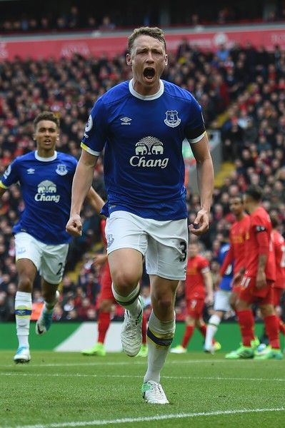 Everton's English defender Matthew Pennington celebrates after scoring their first goal during the English Premier League football match between Liverpool and Everton at Anfield in Liverpool, north west England on April 1, 2017. / AFP PHOTO / PAUL ELLIS / RESTRICTED TO EDITORIAL USE. No use with unauthorized audio, video, data, fixture lists, club/league logos or 'live' services. Online in-match use limited to 75 images, no video emulation. No use in betting, games or single…