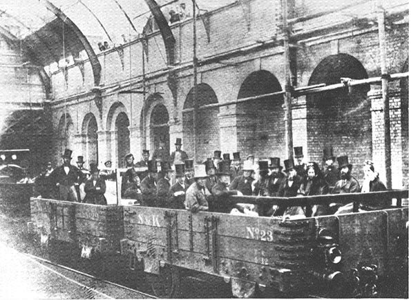 "The Metropolitan Railway, London, before its official opening. 1862. According to Betjeman, ""William Ewart Gladstone, then Chancellor of the Exchequer, is on the right of the man wearing a white hat."