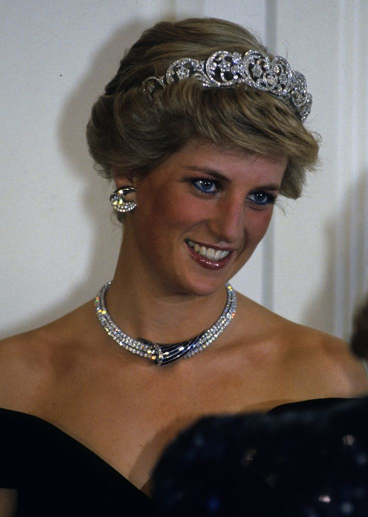 Diana wore the Spencer family tiara and crescent-shaped diamond and sapphire earrings, necklace, and bracel...