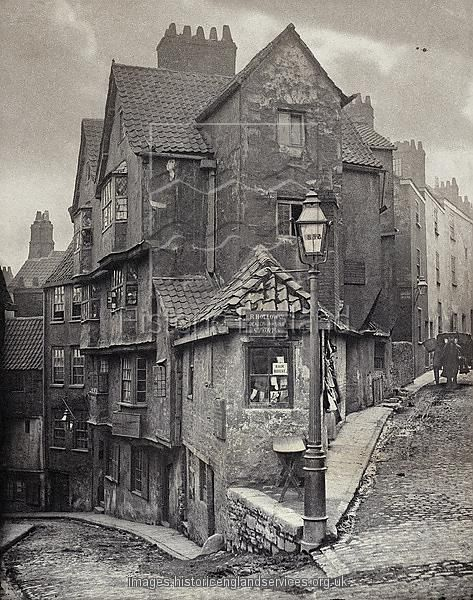 The junction of Steep Street and Trenchard Street, Bristol, 1866. John Hill Morgan (b 1833), platinum print. This view was recorded five years before Steep Street, curving away to the left, was demolished and replaced by a realigned road, Colston Street. Steep Street existed in the medieval period when it was the main road from the centre of Bristol to Gloucester.