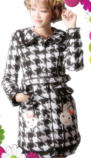 A white and black houndtooth weaved coat that is fully lined in black and quilted.  The pockets at the front have embroidered kawaii rabbits with bows to the ears which are decorated in jewels.  The coat comes with a removable belt.
