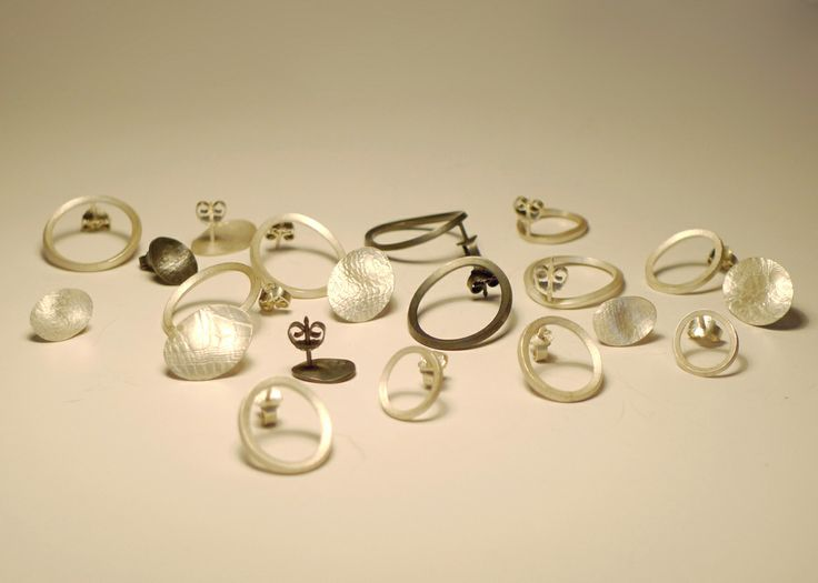Organized mess of earrings. Silver and oxidized silver. By Karina Bach-Lauritsen.