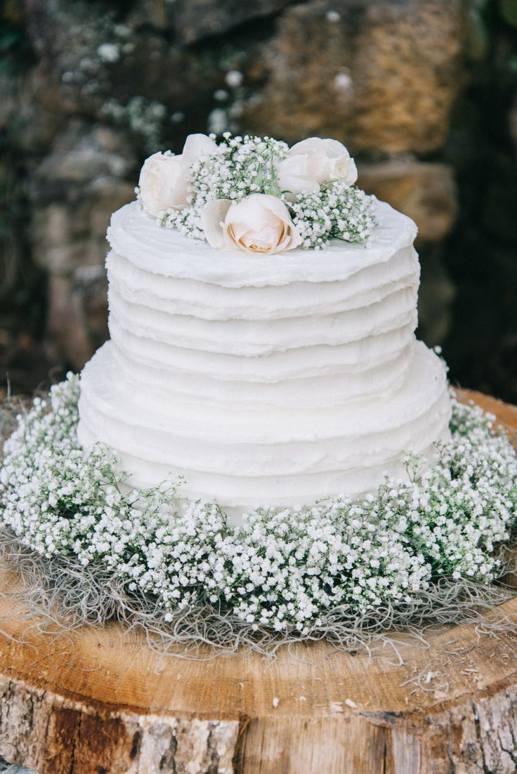Very vintage. Florals complement outdoor winter or spring wedding.