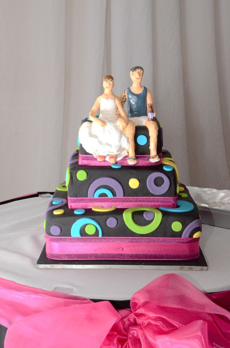Wedding Photographer - Candid Photos of a Lifetime  Personalised cake made by the bride... Cake topper represents the couple - bride with hot pink shoes, groom (how he is normally dressed) complete with replicated arm sleeve tattoo.
