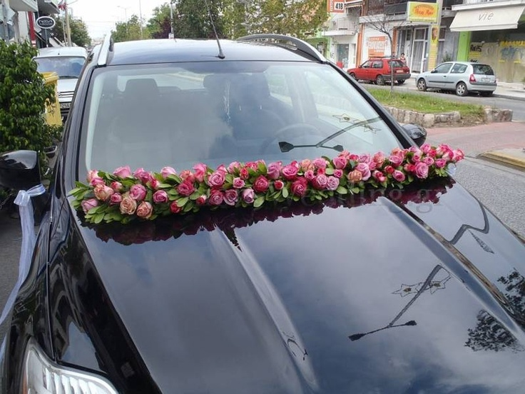 Moustakas flowersw-Wedding car with roses #weddingcar #weddingflowers #decorations #flowerarrangement