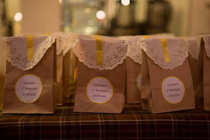 Party goody bags were made using old brown papers bag and paper doiles and yellow ribbon!