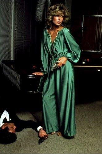Farrah Fawcett in a green satin jumpsuit.