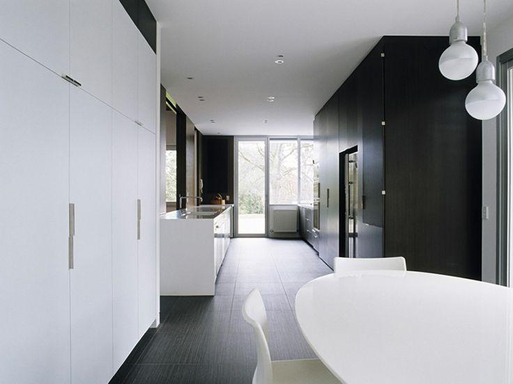 Black and White Kitchen. Bird de la Coeur Architects - McBride House Photos: Shannon McGrath