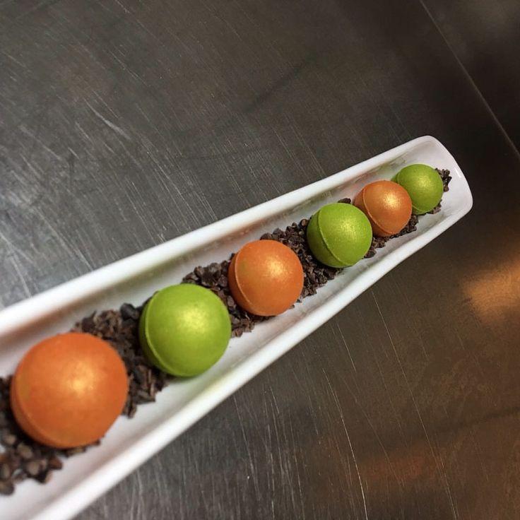 Orange and passion ganache (Orange) Mint ganache (green) #ivoire #guanaja #mint #orange #passionfruit #valrhona #apapastavrou #argiris_papastavrou #patmos #patmosaktis #emerald #patisserie