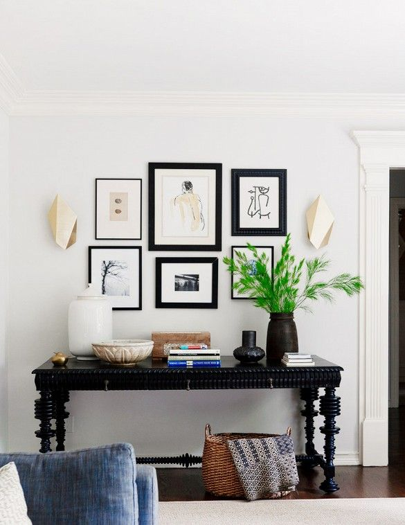 A gorgeous gallery wall over an elaborate console table