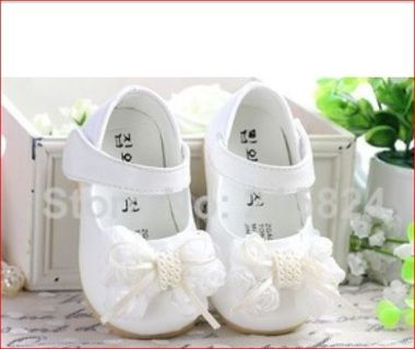 Beautifully soft white polyurethane shoes with bowtie embellishment with pearls - great for little girls and junior bridesmaids - also for christenings   shoe measures 17cm - inner shoe size 13.5cm -   Small child wear  Suit small child or junior bridesmaid   Postage charges apply  BUDGET BRIDAL FLOWERGIRL
