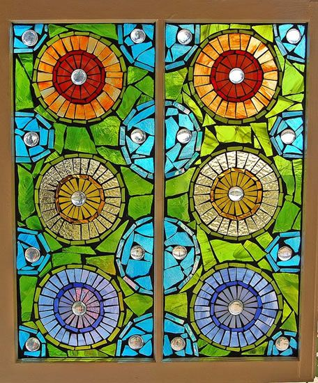 Mandala stained glass mosaic window by grey dog studio