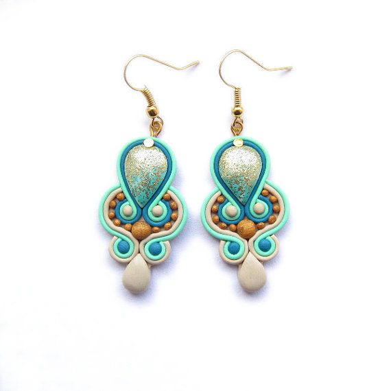 These earrings are created by me from Fimo polymer clay. They are inspired by soutache. They are modern and romantic. I made them in light mint, gold and