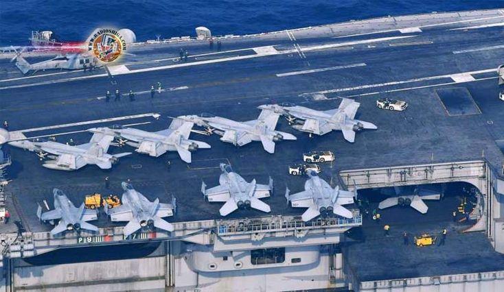 Porta-aviões norte-americano USS Carl Vinson, navega ao largo de Nagasaki. A NHK revelou que o grupo de ataque naval dos EUA liderado pelo porta-aviões USS