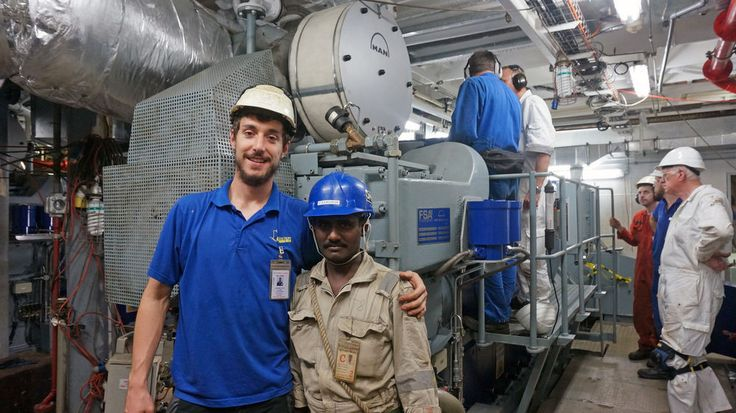 Logos Hope Electrician Johannes Hotz (Austria) pauses for a photo with one of the Keppel Shipyard workers.   http://www.omships.org/index.php?option=com_content