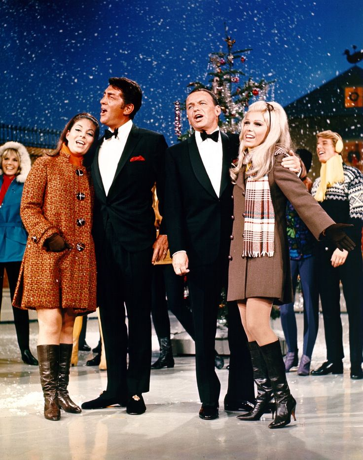 Deana Martin, Dean Martin, Frank Sinatra and Nancy Sinatra perform on a Christmas special TV show in December 1967
