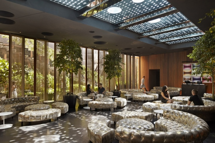 Lobby lounge with garden and teak framed lightwell to pool