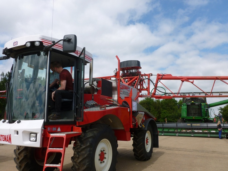 MM's Heather and a friend trying out the Bateman 4000 crop sprayer for size.