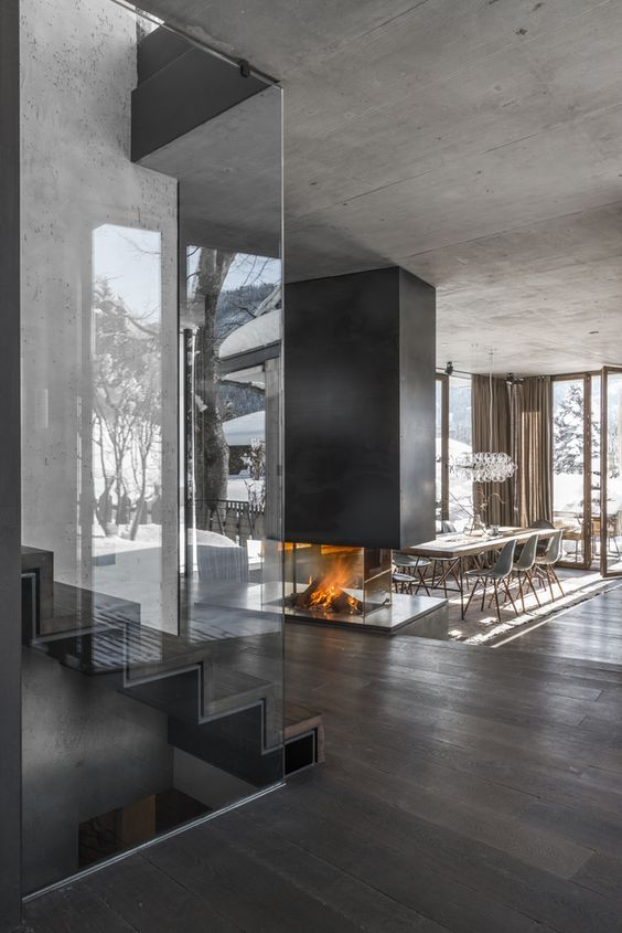 Designed by Gogl Architekten, the striking open fireplace was built by Mandl & Bauer stove fitters.: