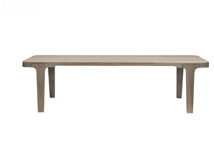 The rectangular Lago table, designed in 2010 for Linteloo, is made of solid wooden oak with inward-facing legs. | LINTELOO