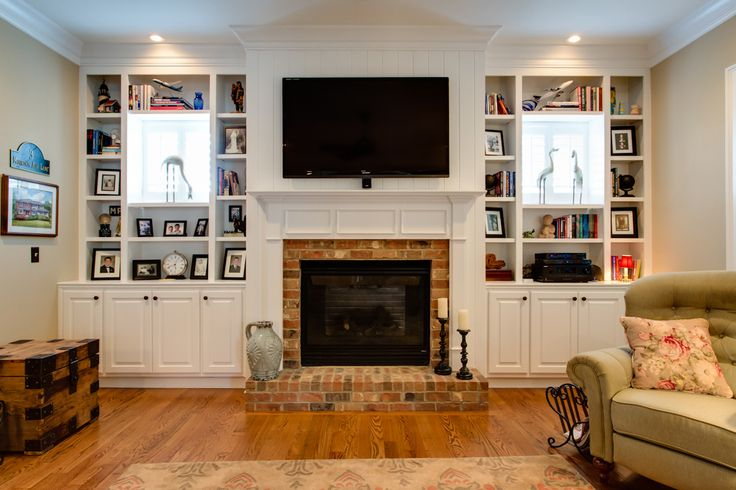 bookcases built out around windows Wando View Home in Daniel Island, SC by JacksonBuilt Custom Homes