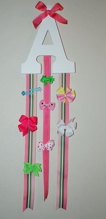 Wooden letter from hobby lobby with ribbon. To hold all of those bows and hair clips