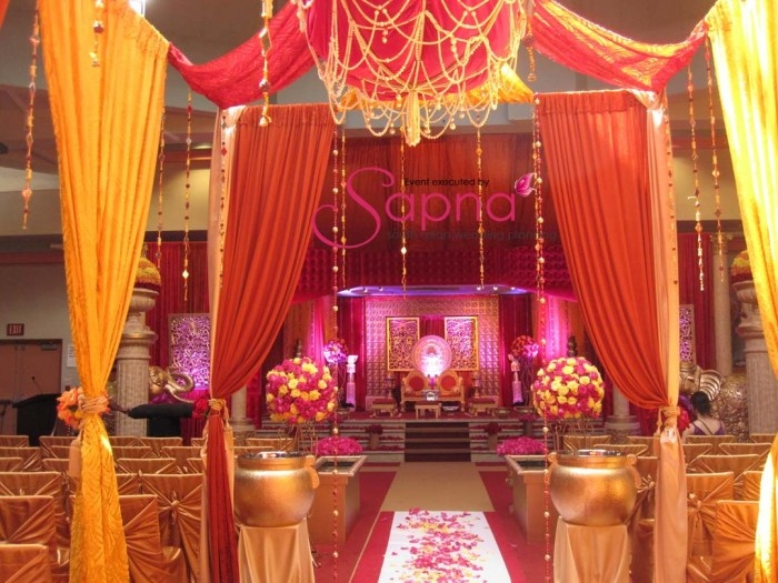 Mandap and aisle decor red and yellow wedding for Pink and yellow wedding theme ideas