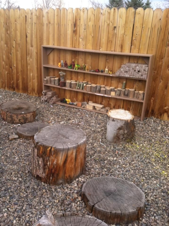 stumps as stages for play, plus shelves of small toys and loose parts. It would be great to double the stumps around the firepit