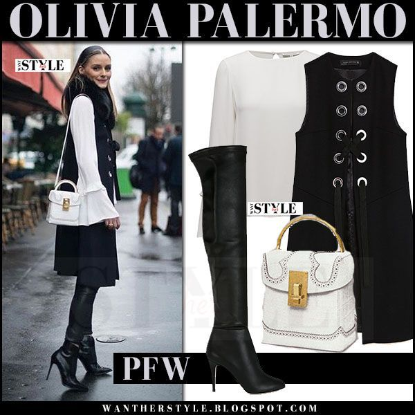 Olivia Palermo in black waistcoat with black boots and white shoulder bag in Paris on March 7