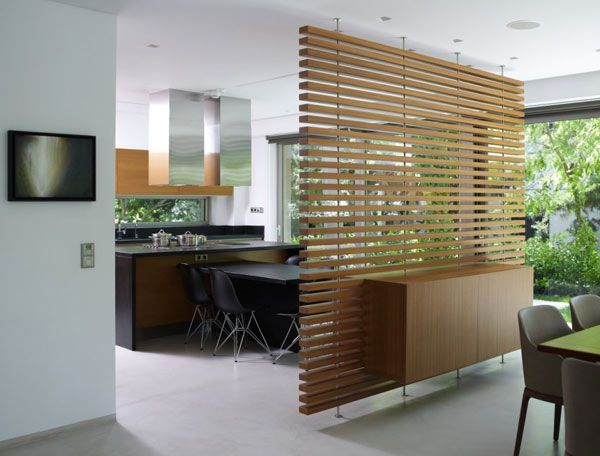 Clever wooden slatted partition wall between dining area and kitchen