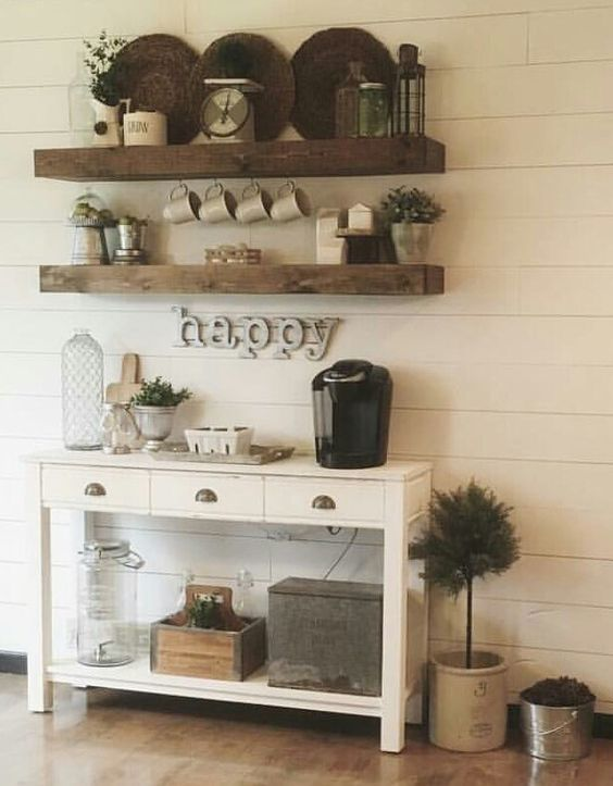 rustic coffee and tea station with open shelving and a simple console table