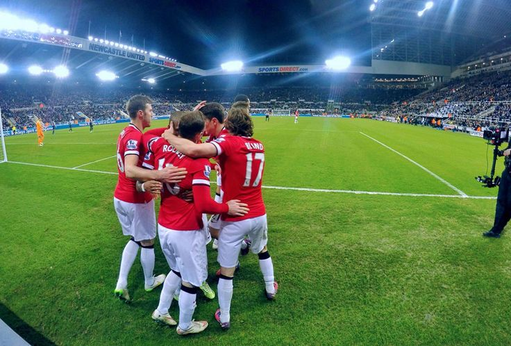 Manchester United's Ashley Young celebrates with his teammates after scoring in the 88th minute to give United victory over Newcastle at St James Park.