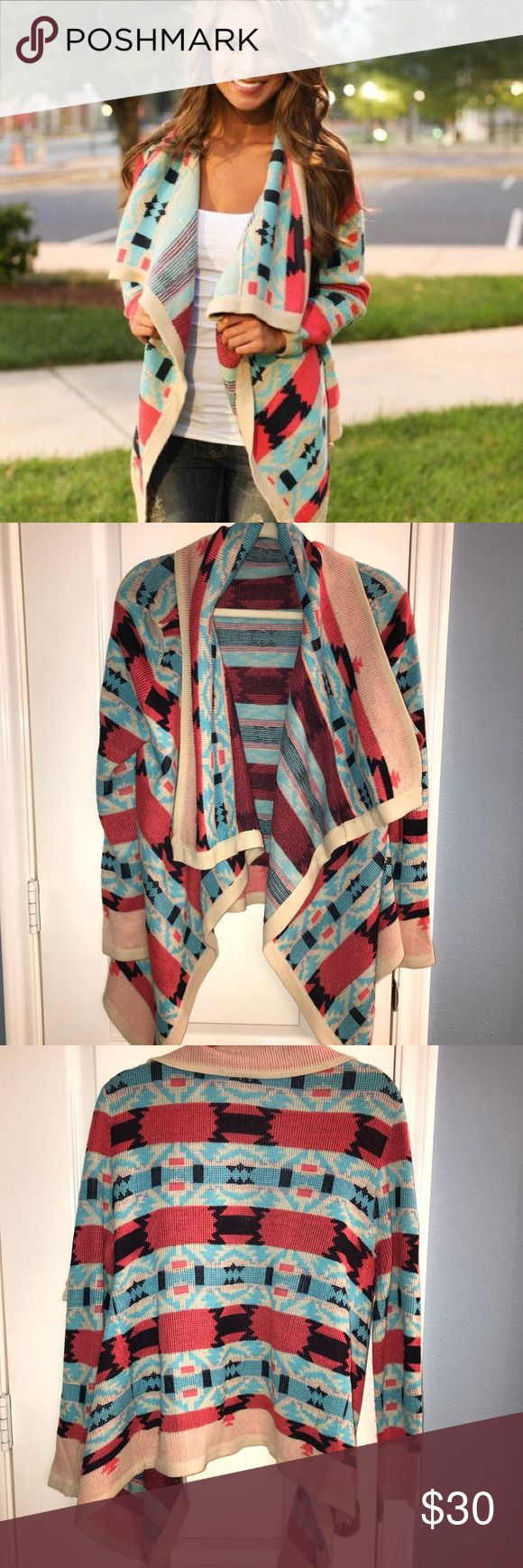 Tribal print cardigan Tribal print cardigan in cream, blue and coral. Warm and cozy with a pop of color for a dreary winter. Size medium. Sweaters Cardigans