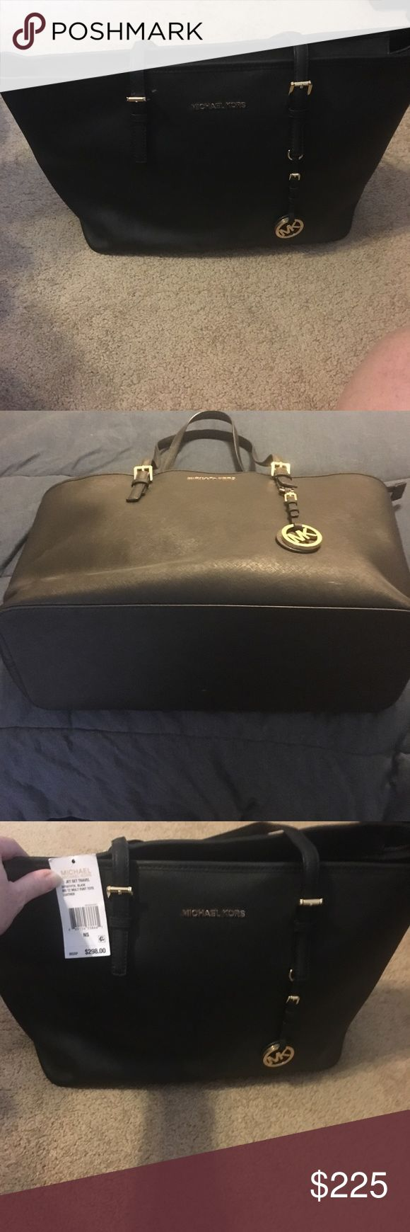 Michael Kors Jet Set Travel Tote, New with Tags This jet set travel tote carries everything you need and is amazing. In black leather with room for a computer and all your goodies when you are traveling. I am selling because I found it too big after I purchased and I was no longer returnable. Let my loss be your gain KORS Michael Kors Bags Laptop Bags