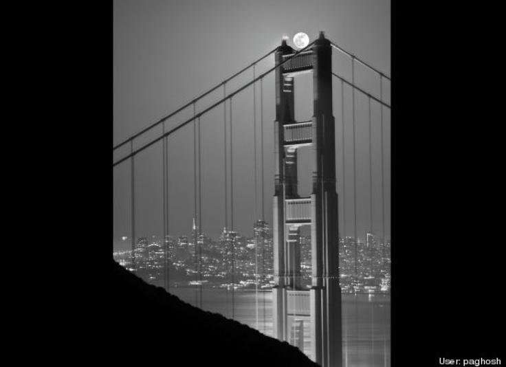 Golden Gate Bridge holding up the Super Moon
