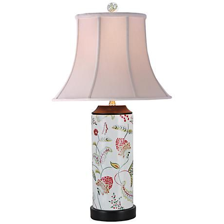 A porcelain table lamp with a colorful floral design.