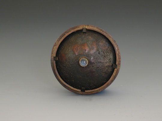 "DAVID H. CLEMONS - brooch  Untitled  2009  Sterling silver, Bronze, Moonstone  1.5"" Diameter"