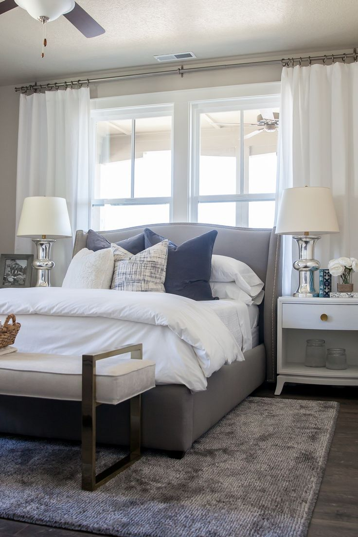 Alice Lane Home Collection Daybreak Lake Loft Gray upholstered bed in  Master Bedroom, white bedding and neutral decor Lindsay Salazar Photography