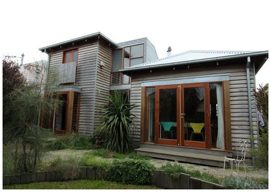 Rear addition. Love the wood cladding and glass doors.