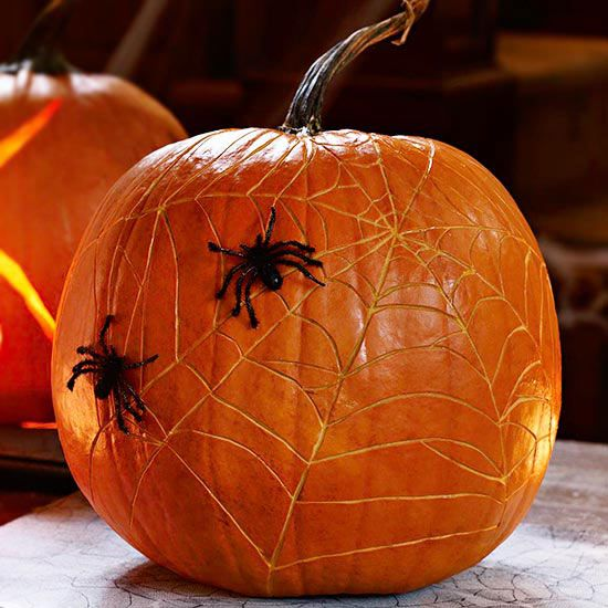 Creepy spiders are a great way to have your guests leave shaking! More spooky pumpkin ideas: http://www.bhg.com/halloween/pumpkin-carving/cool-halloween-pumpkins/?socsrc=bhgpin100713spiderwebpumpkins&page=9