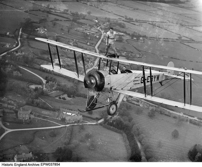 Martin Hearn wing walking on Aviation Tours Ltd Avro 504K G-EBYW, 1932 Image reference EPW037854 Date May 1932