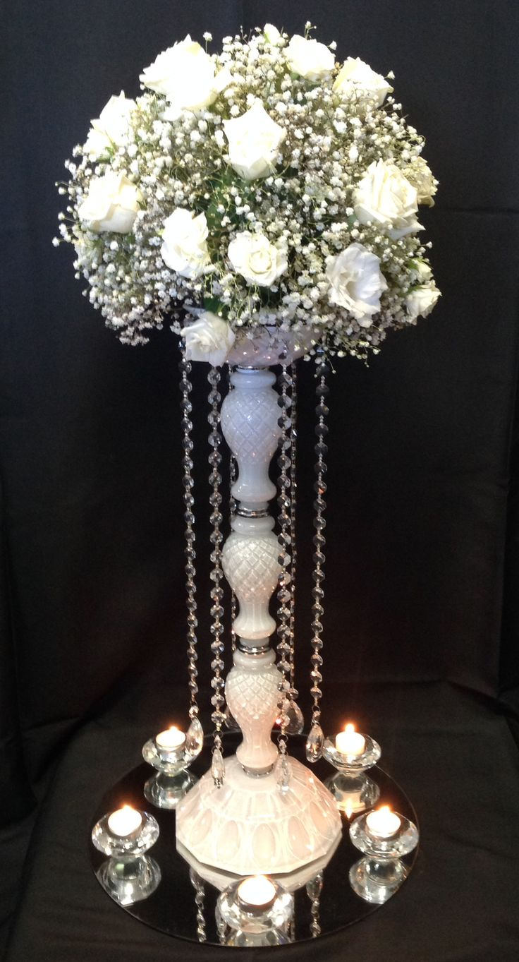 Adelaide hire of our white glass centrepiece with crystal beads and fresh flower arrangement on top. Sitting on a mirror base with 5 crystal tea light holders.  www.houseofthebride.com.au