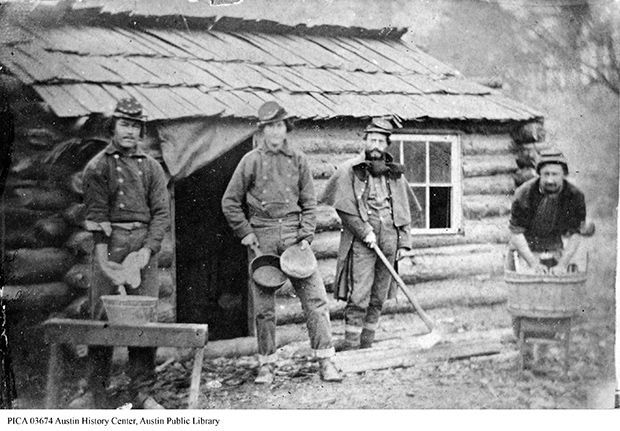 These photos of the 1st Texas Infantry in winter quarters at Camp Quantico near Dumfries, Va. during the winter of 1861-62 show them wearing forage caps with brass letters designating their company and regiment, similar to that worn by Lt. Eli H. Baxter, Jr. Looks like some may also be decorated with Texas stars.
