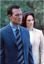 Special Agents John Doggett and Monica Reyes from THE X FILES.